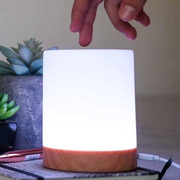 person activating friendship lamp
