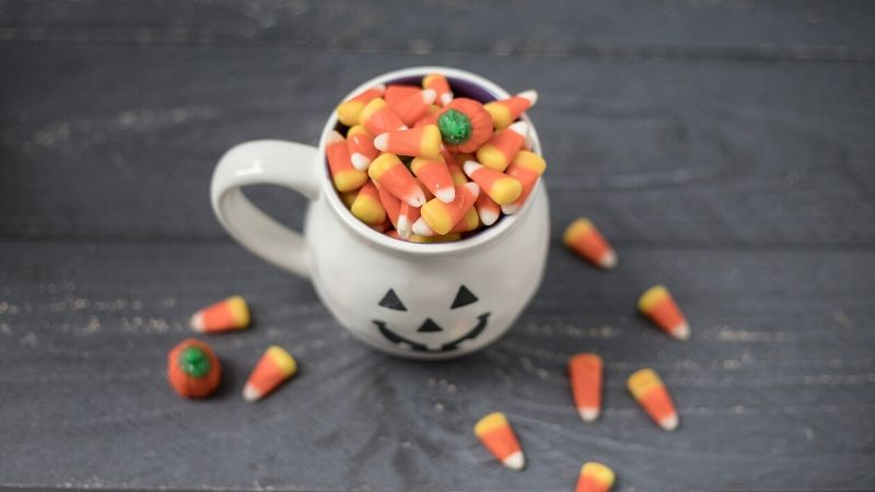 kettle corn in a pumpkin mug for a halloween care package
