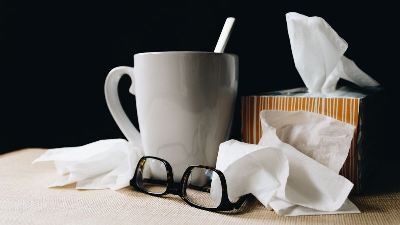 hot drink and tissues from a sick care package