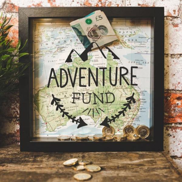 Customizable travel fund box with money inside