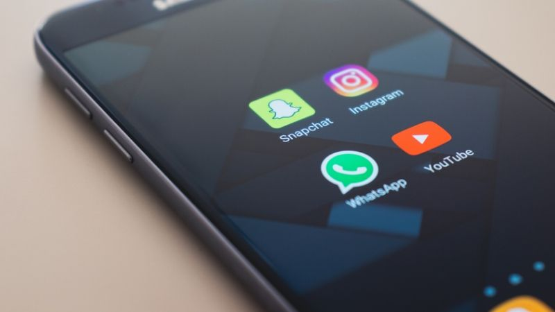 smartphone showing whatsapp icon for a family group chat
