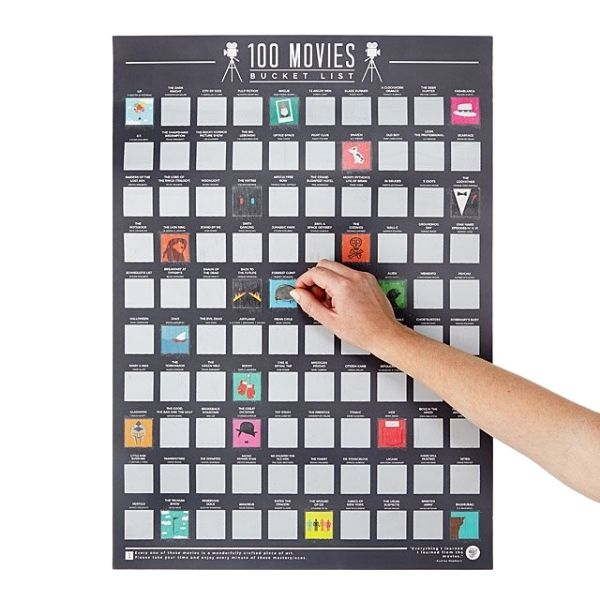 Hand scratching off 100 Movies Scratch Off Poster