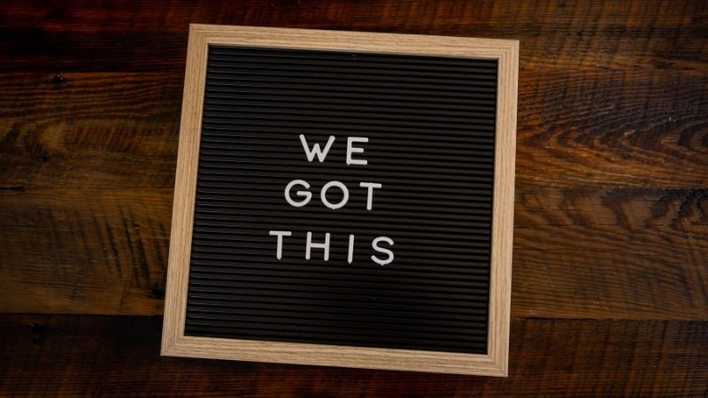 sign saying 'we got this' on wood table