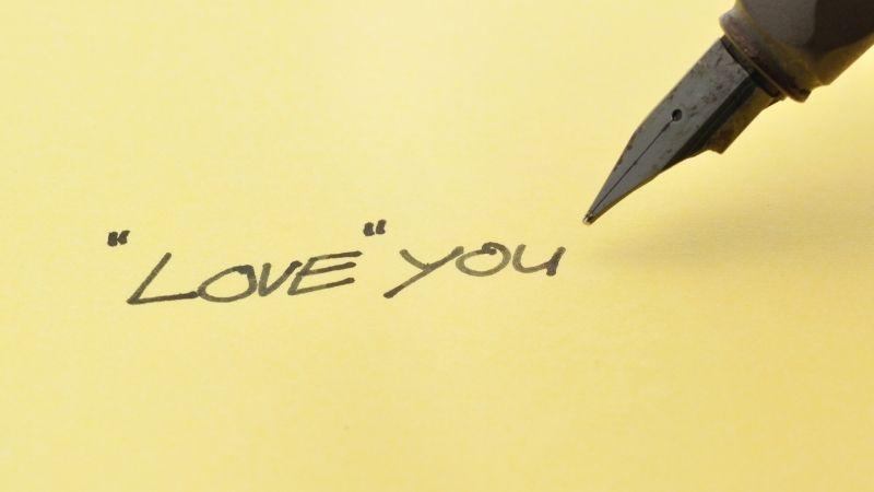 love you written in ink pen