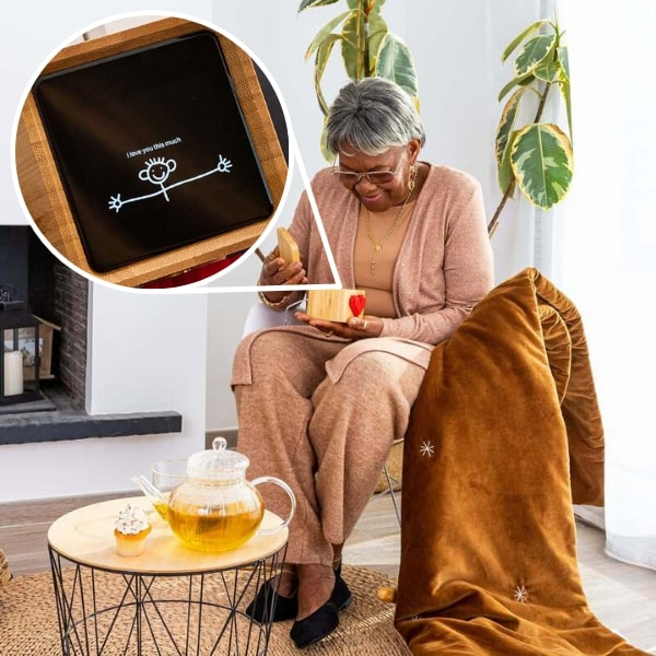 long distance grandparent opening lovebox to see message from grandchild