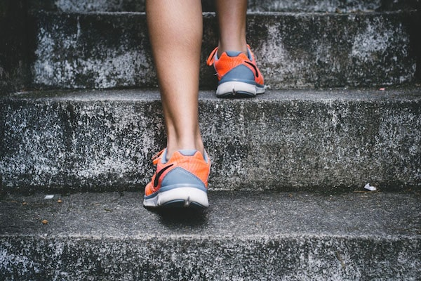 physical exercise person running up stairs